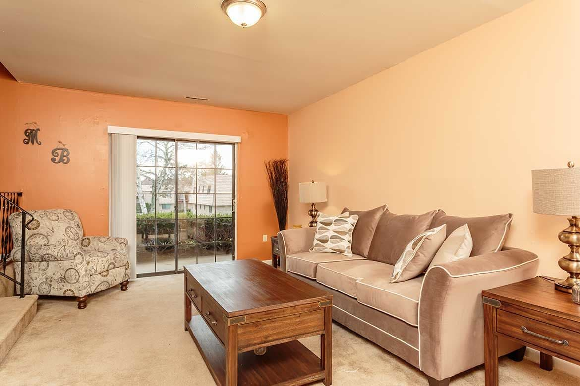 Well decorated living room at Meadowbrook Apartments in Slingerlands, NY