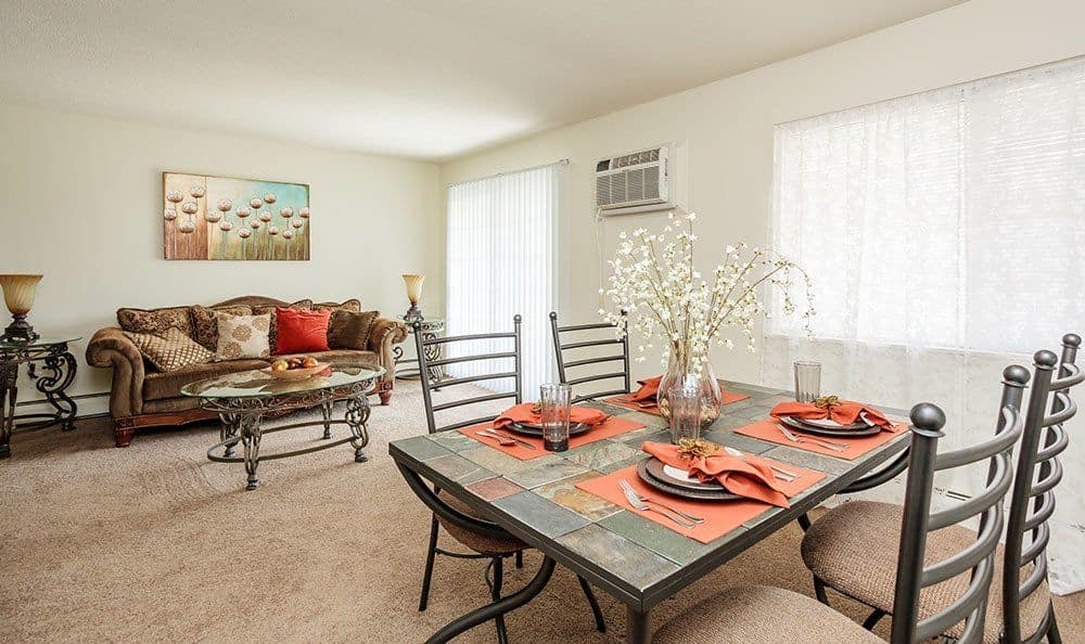 Dining area and living room at Brookwood on the Green home in Liverpool, NY