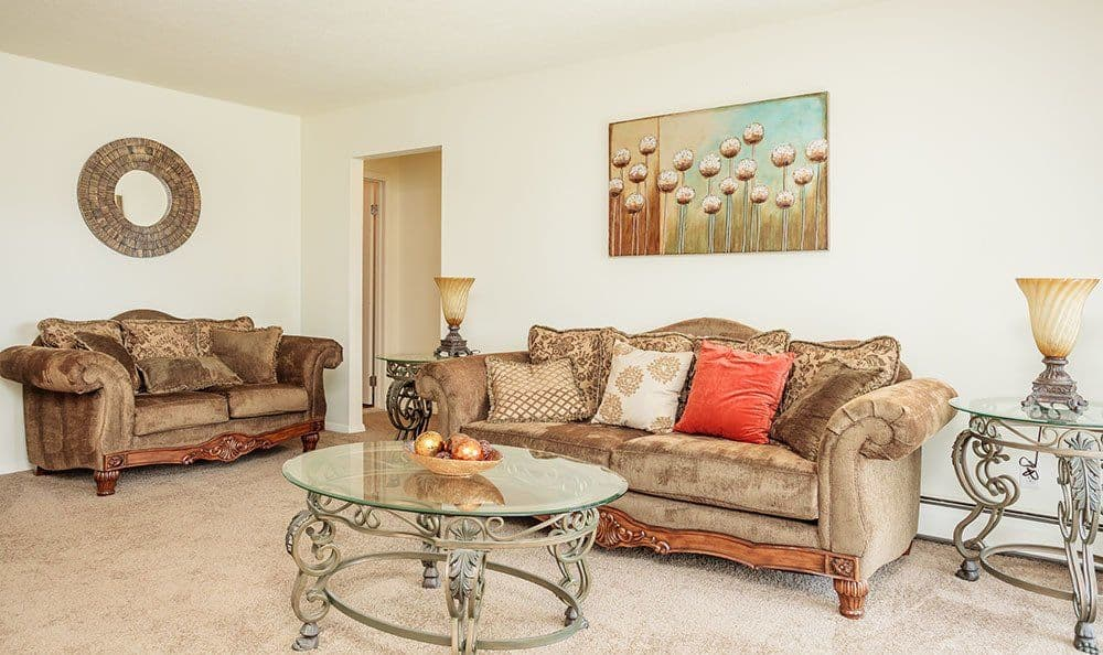 Cozy living room at Brookwood on the Green home in Liverpool, NY