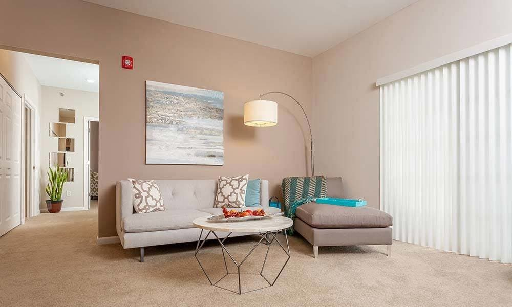Natrually well-lit living room at Reserve at Southpointe in Canonsburg, Pennsylvania