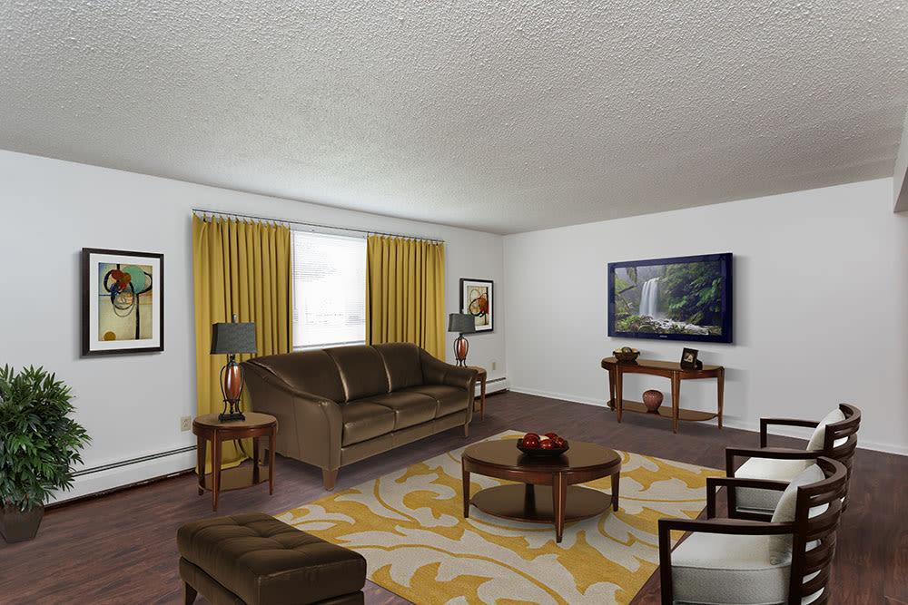 Beautifully designed living room at Perinton Manor Apartments in Fairport
