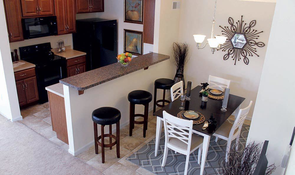 View of dining room and kitchen at The Encore at Laurel Ridge in Harrisburg, PA