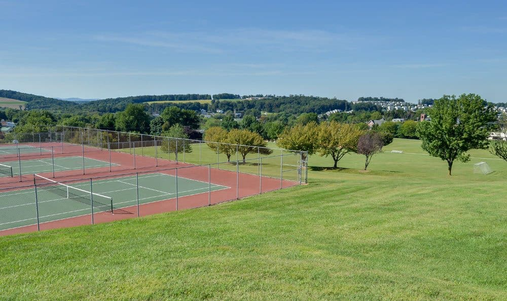 A tennis court is onsite for your enjoyment at Lion's Gate Townhomes