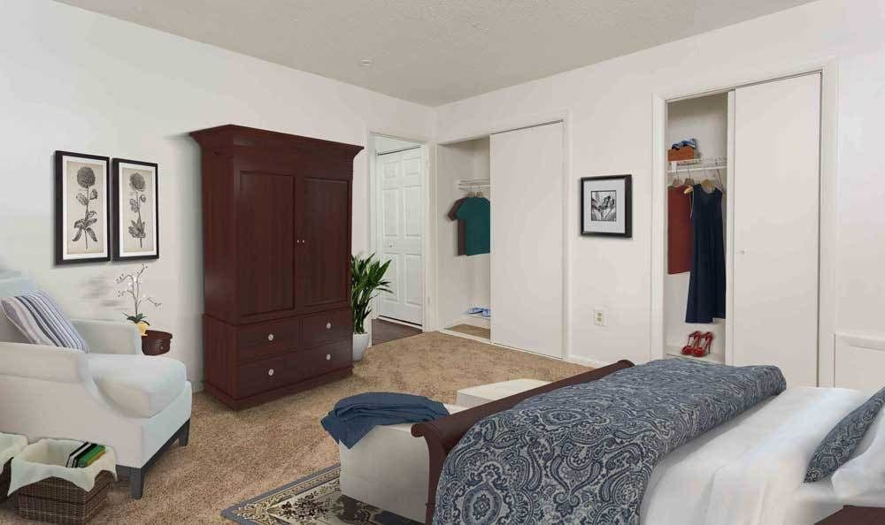 Cozy bedroom with closets at Highland Club in Watervliet, NY