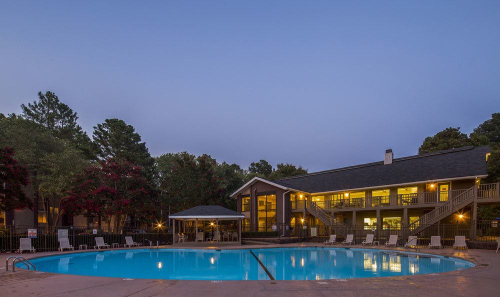 Swimming pool at night at The Trails of North Hills