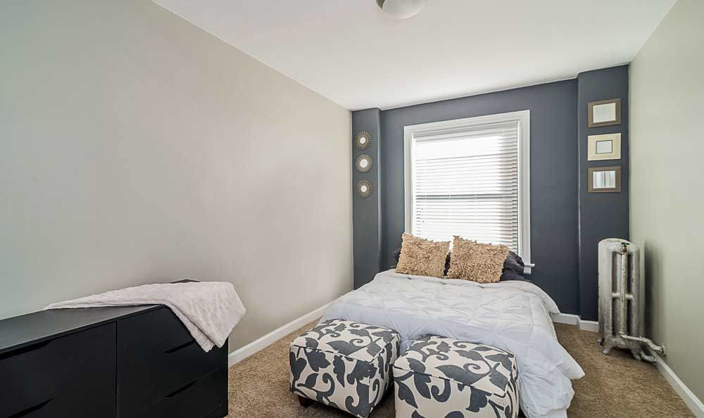 Comfortable bedroom at 7100 South Shore Drive Apartments in Chicago