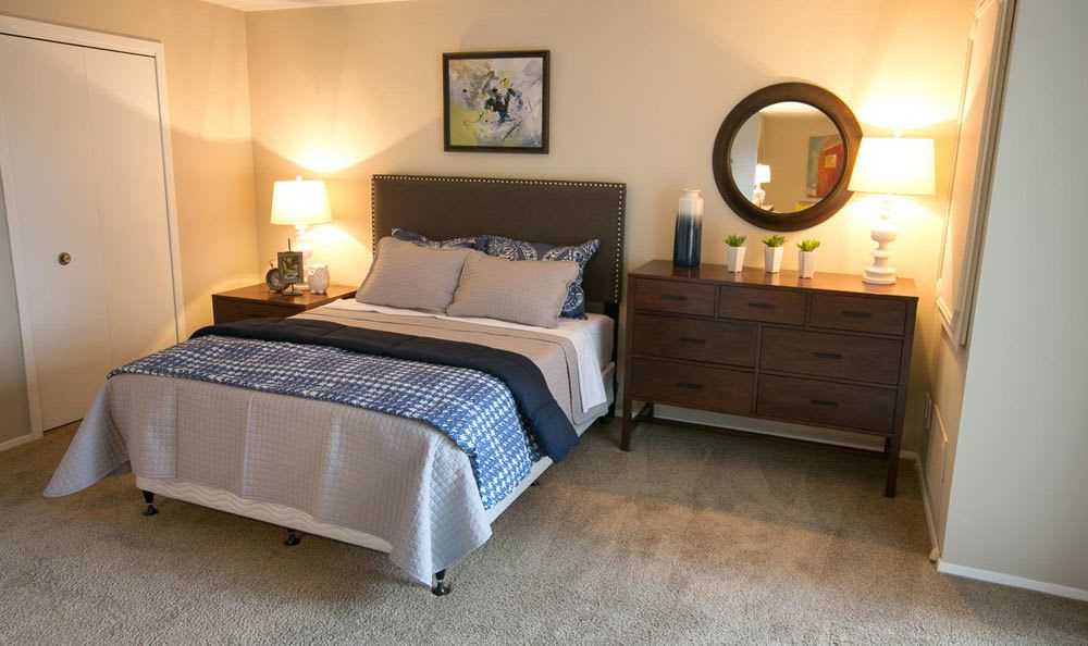 Well decorated bedroom at Deville Apartments in Beachwood