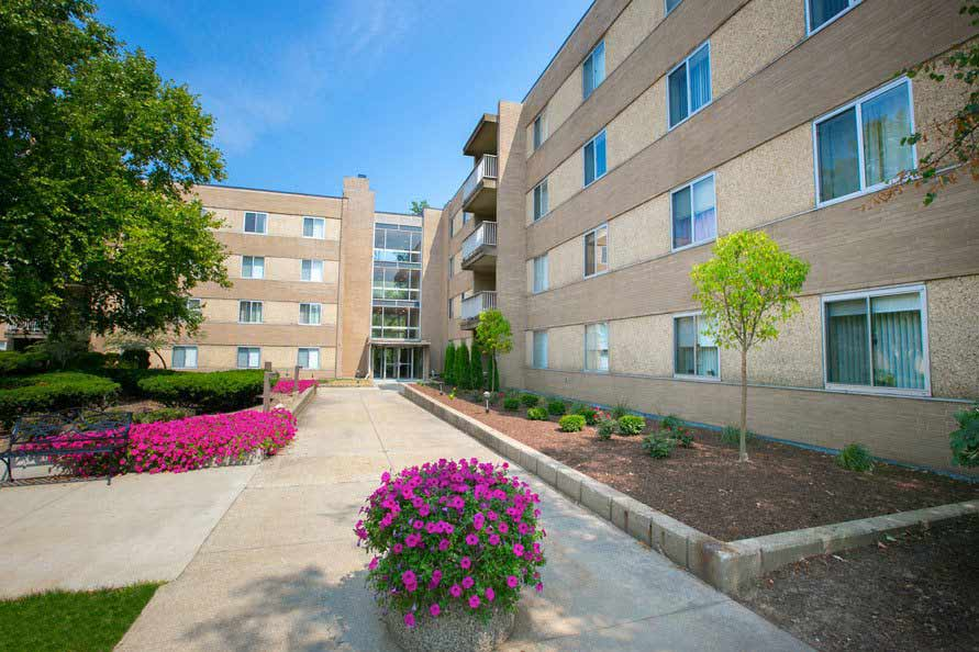 Beautiful exterior of apartments at Deville Apartments in Beachwood