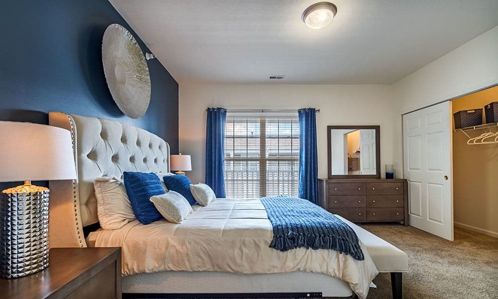 Bright inviting bedroom at The Docks Apartments