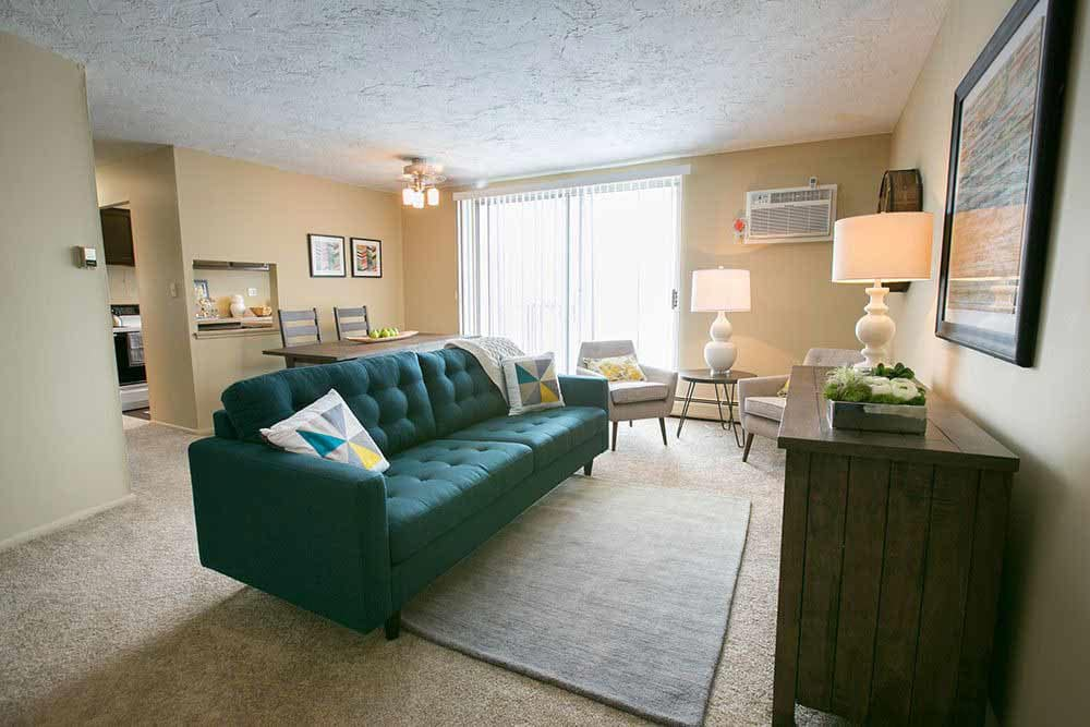 Bright inviting living room at The Drake Apartments