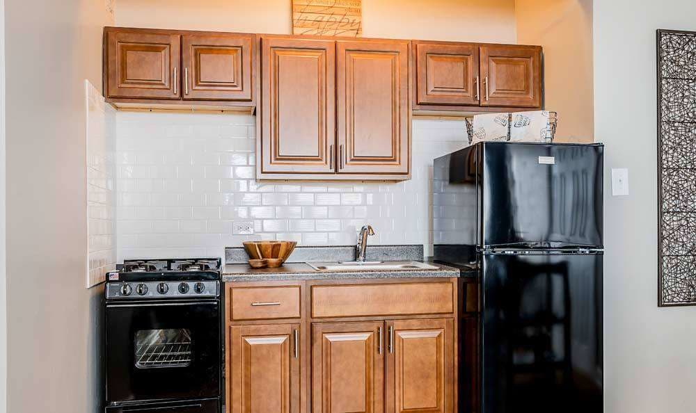 Full-equipped kitchen at 7100 South Shore Drive Apartments in Chicago