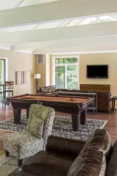 Clubhouse with billiards table at The Trails of North Hills in Raleigh, NC