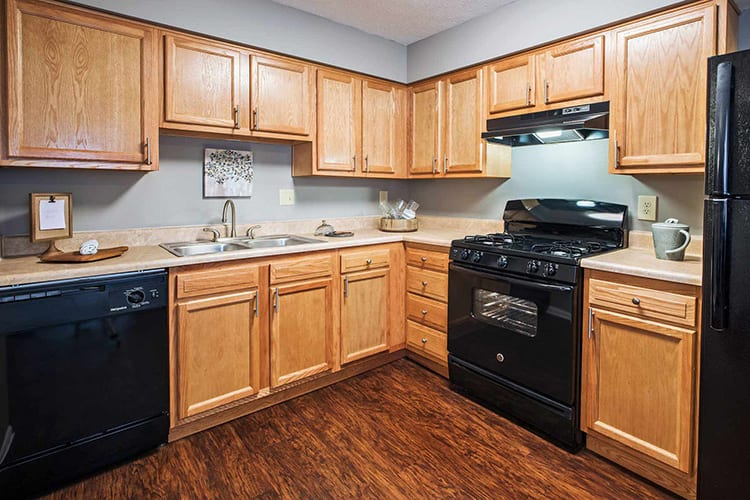 Modern kitchen with black appliances at The Edge At Arlington