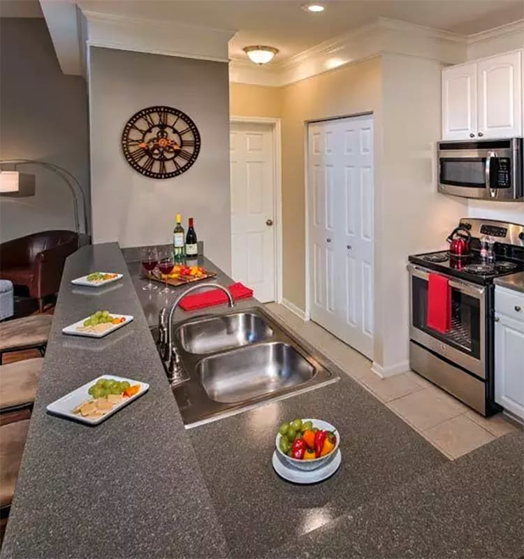View of modern kitchen in apartment home at The Waterfront Apartments