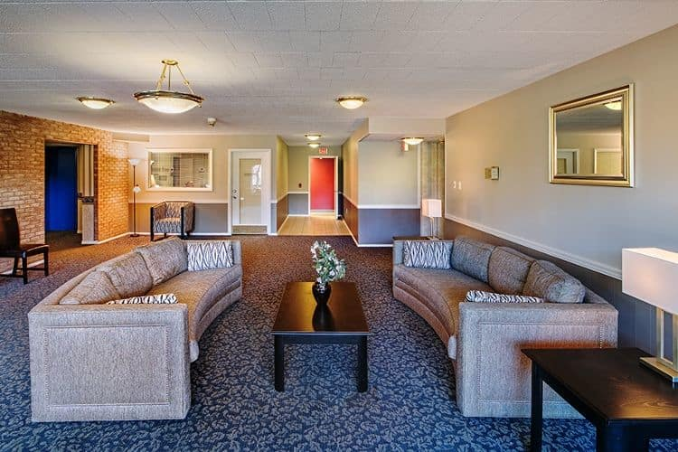 Clubhouse interior at Avalon Arms Apartments