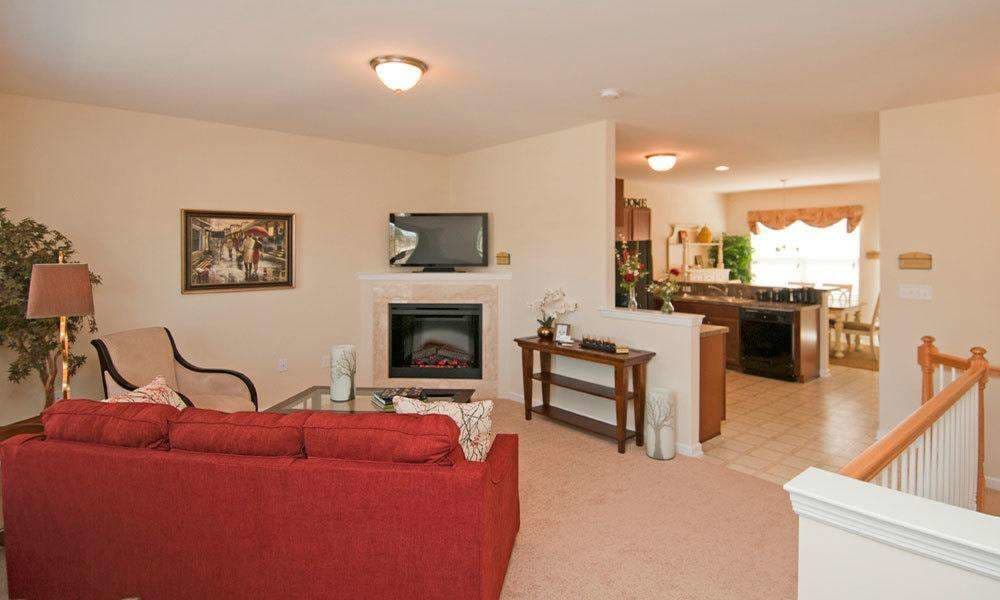 Well decorated living room at Emerald Pointe Townhomes in Harrisburg