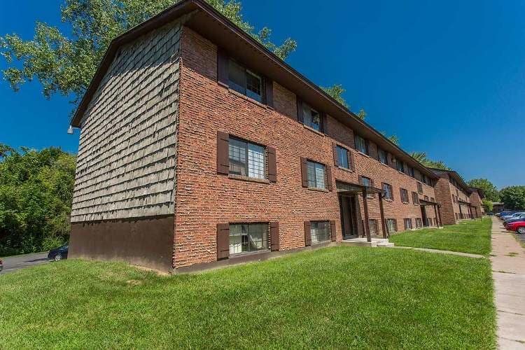 Exterior view of apartment building at The Residences at Covered Bridge in Liverpool, NY
