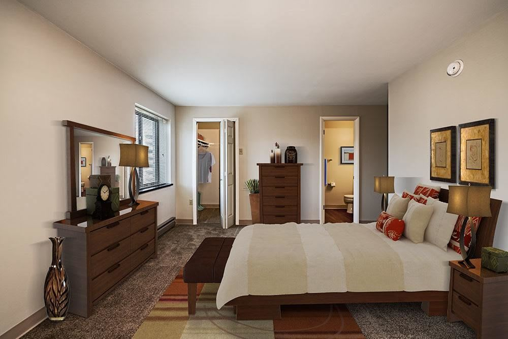 Bedroom with closet at Maiden Bridge & Canongate Apartments in Pittsburgh
