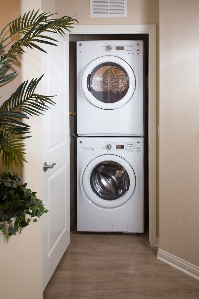 Stacked washer and dryer at Palisades Sierra Del Oro in Corona, California