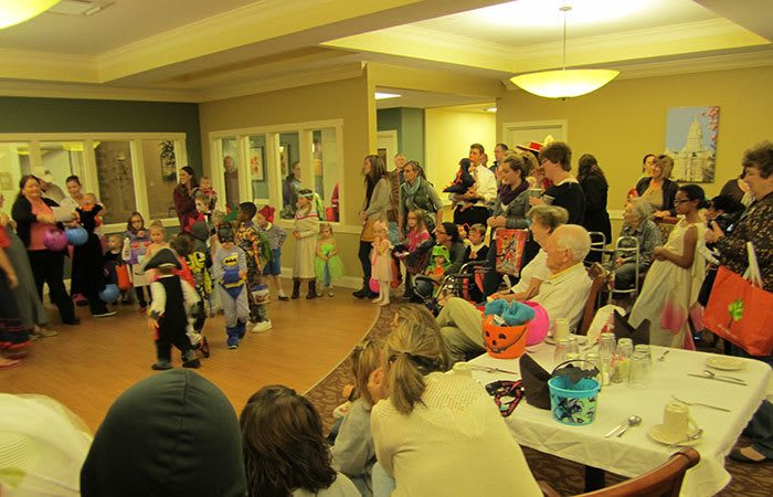 Residents watching a performance by local school at Randall Residence of Tipp City in Tipp City, Ohio