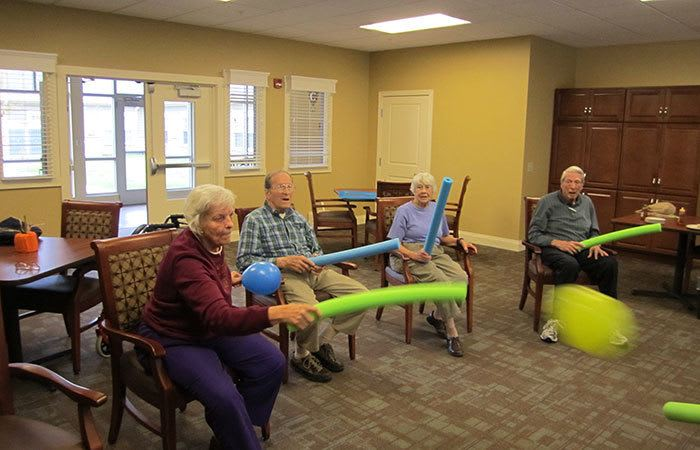 Group of residents playing a game with pool noodles at Randall Residence of Tipp City in Tipp City, Ohio