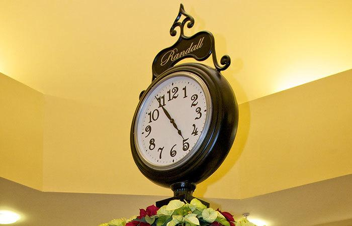 Indoor street clock in a common area at Randall Residence of Tipp City in Tipp City, Ohio