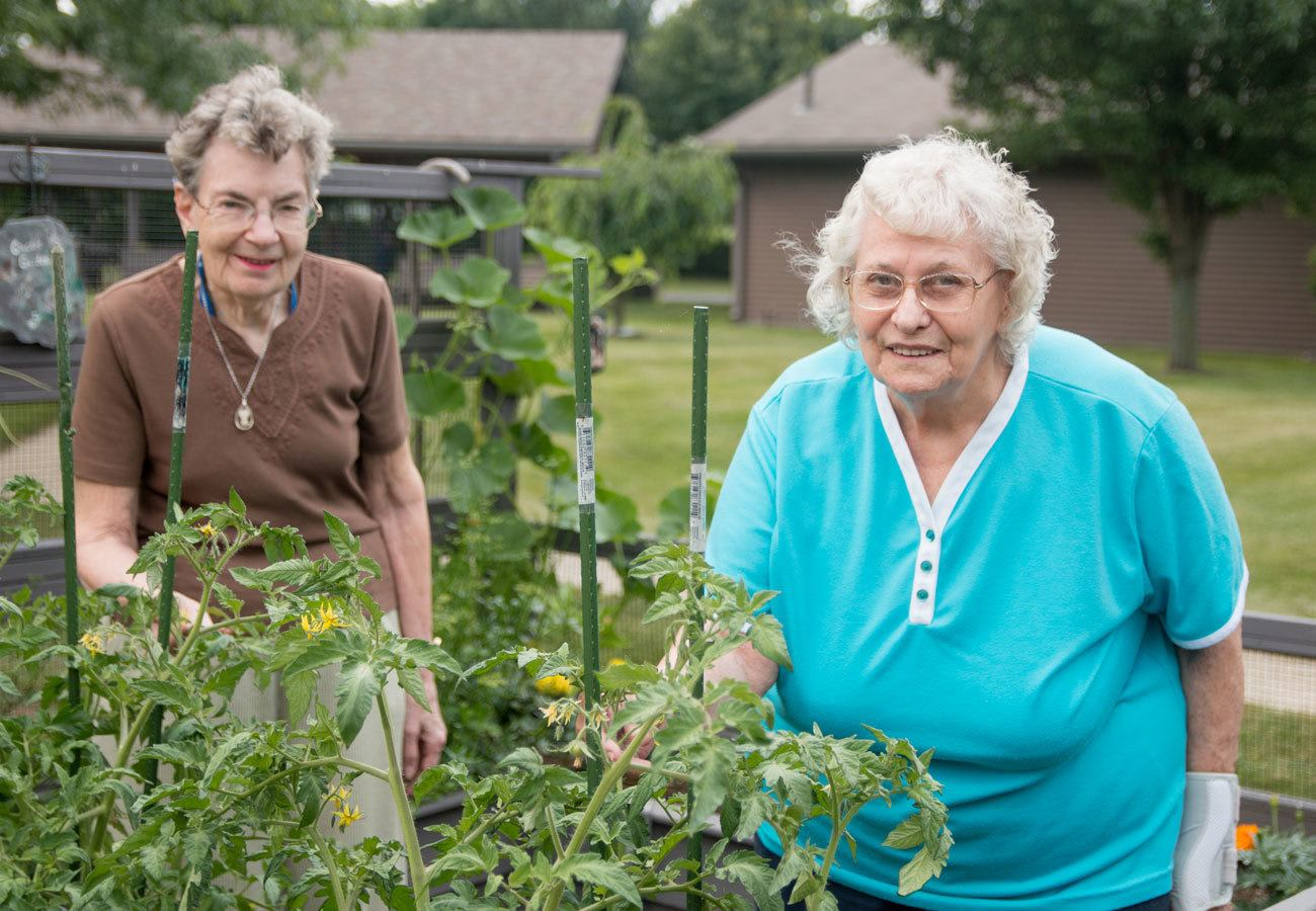 Two residents outside gardening at Villa at the Lake in Conneaut, Ohio