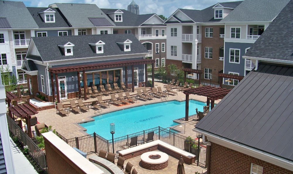 A modern apartment building and adjacent parking at Cambria at Cornerstone in Virginia Beach, Virginia