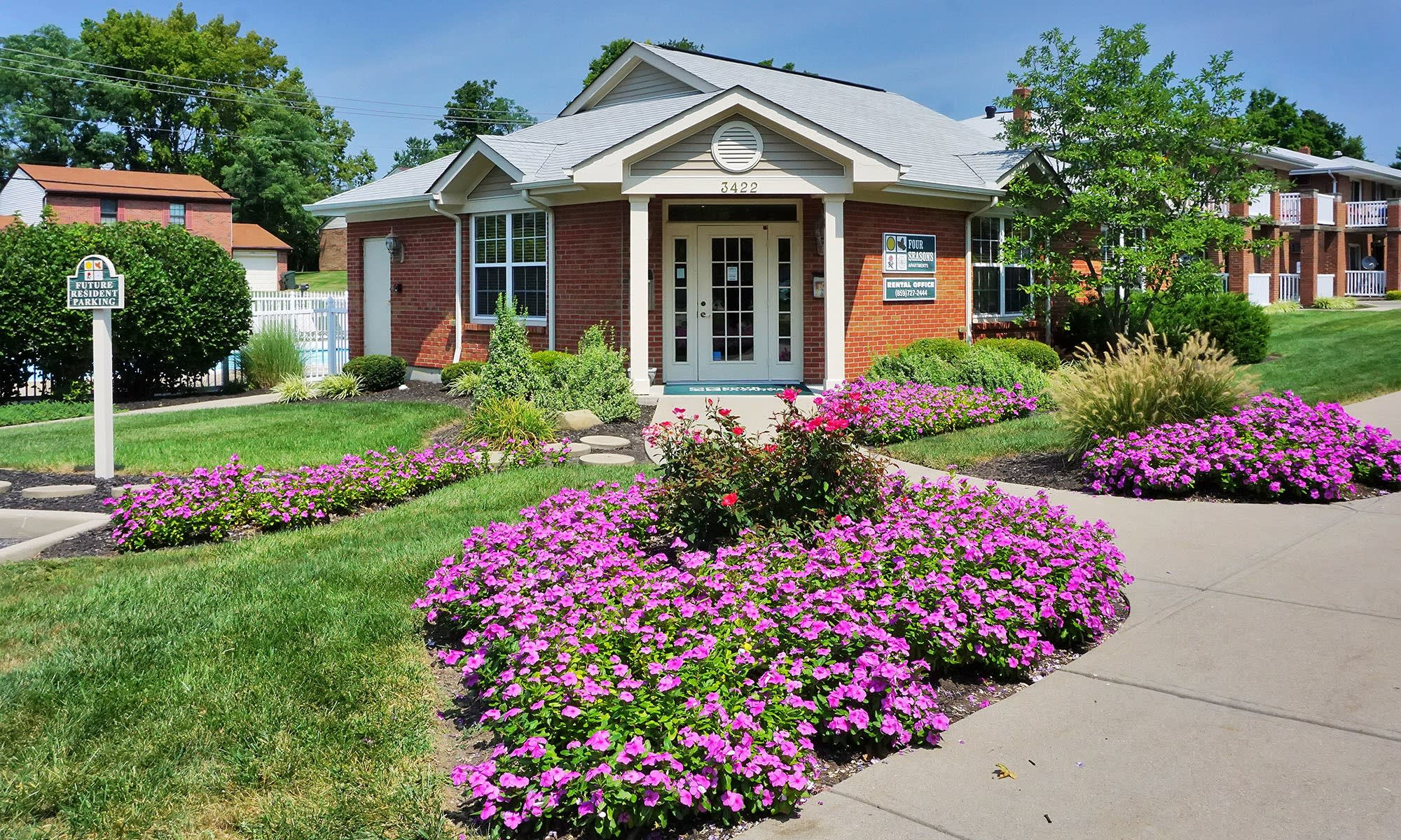 Beautifully landscaped entrance to the leasing office at Four Seasons Apartments in Erlanger, Kentucky