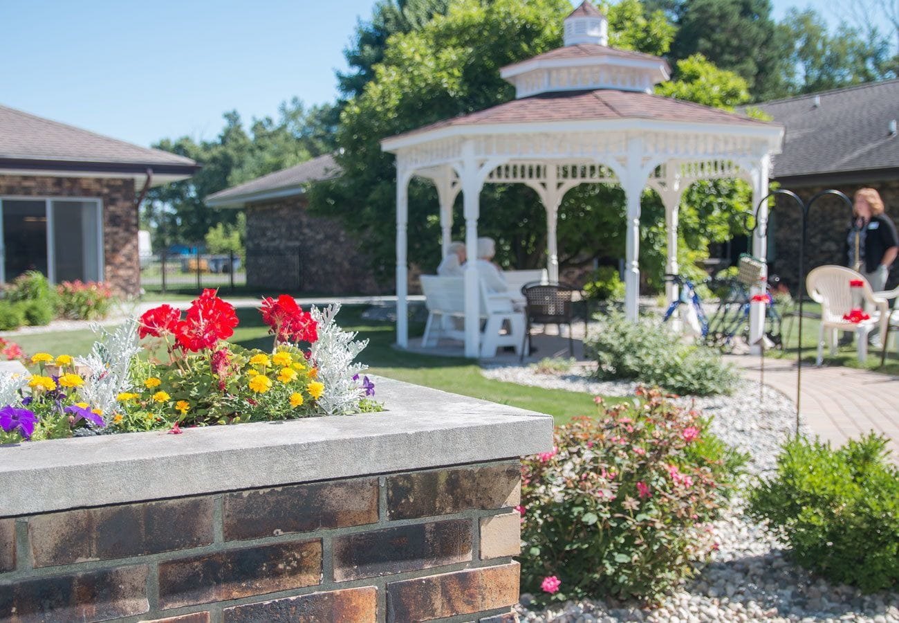 Patio with a white gazebo at White Oaks in Lawton, Michigan