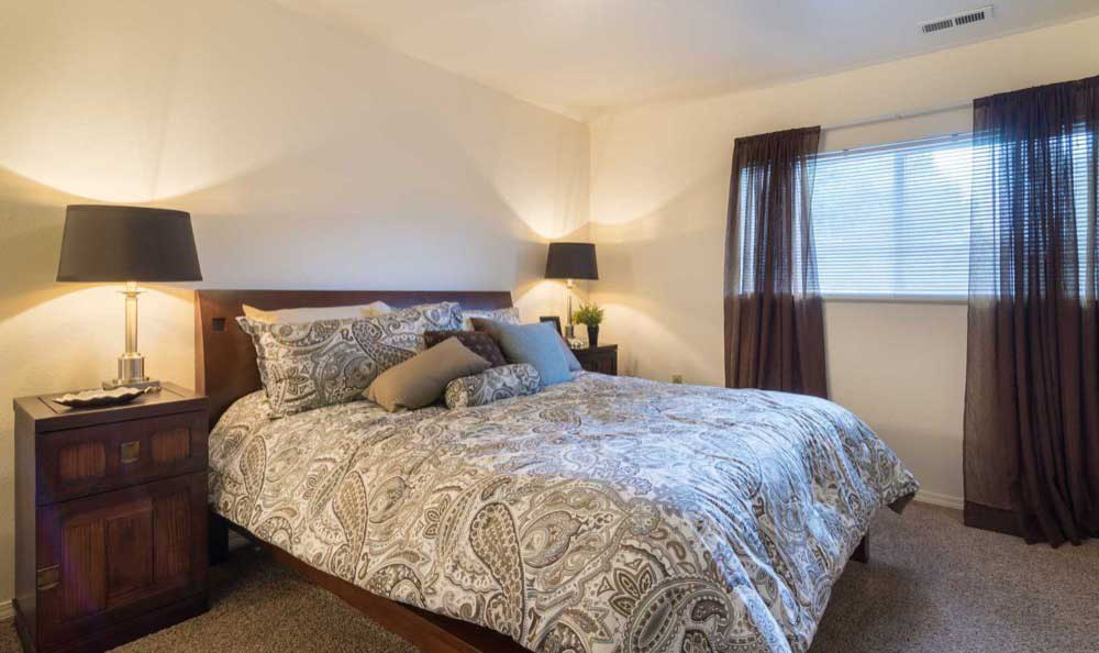 Beautiful Bedroom at Arbor Crossing Apartments in Boise, ID