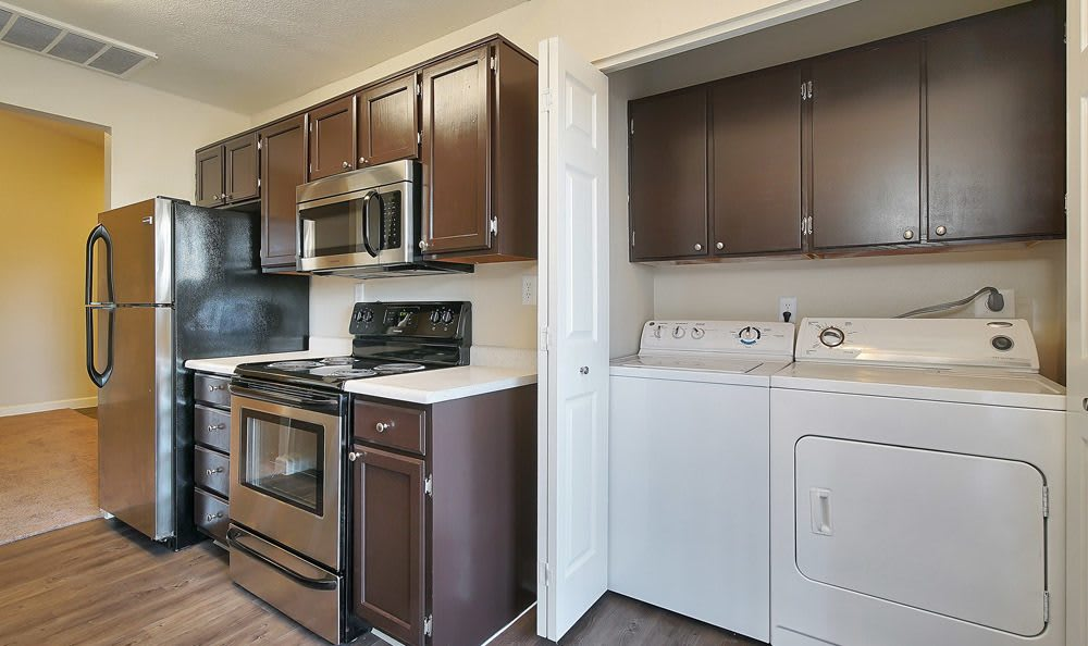 Modern kitchen and washer and dryer at Renaissance Apartment Homes