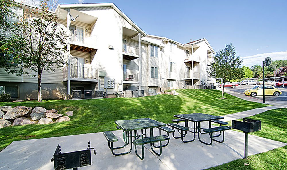 Cherry Lane Apartment Homes feature common area with picnic tables in Bountiful