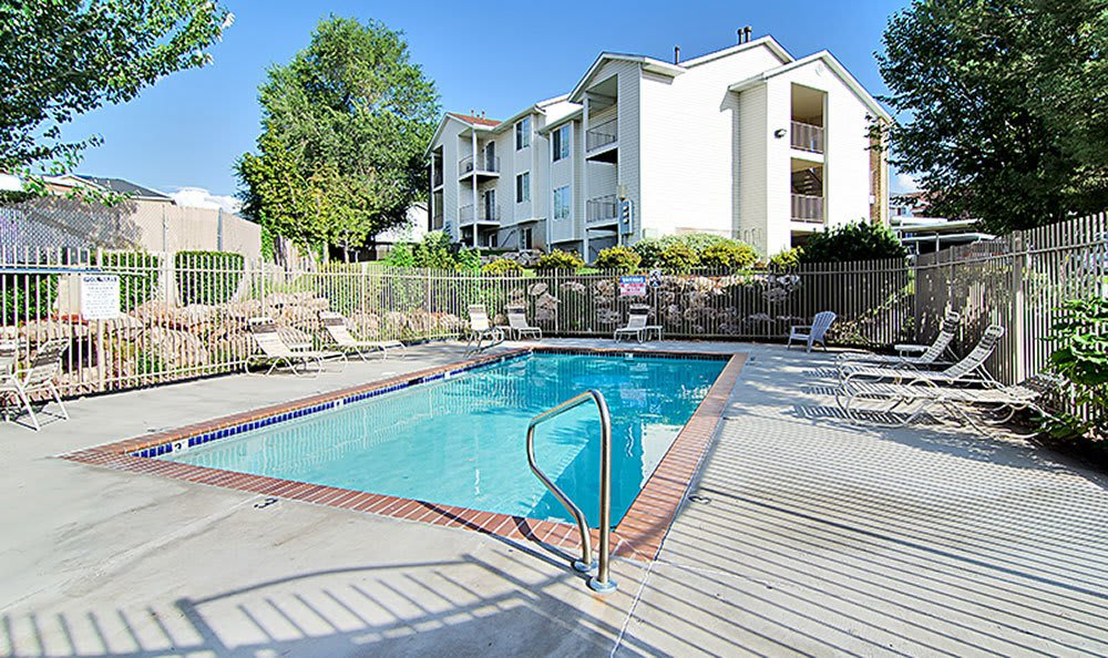 Cherry Lane Apartment Homes offers a sparkling swimming pool in Bountiful