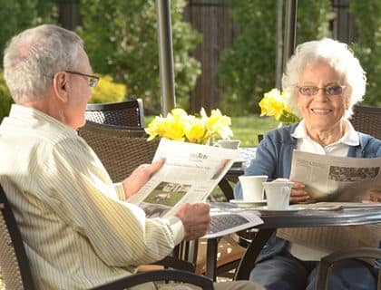 Resident couple enjoy their mornings together at Symphony Manor