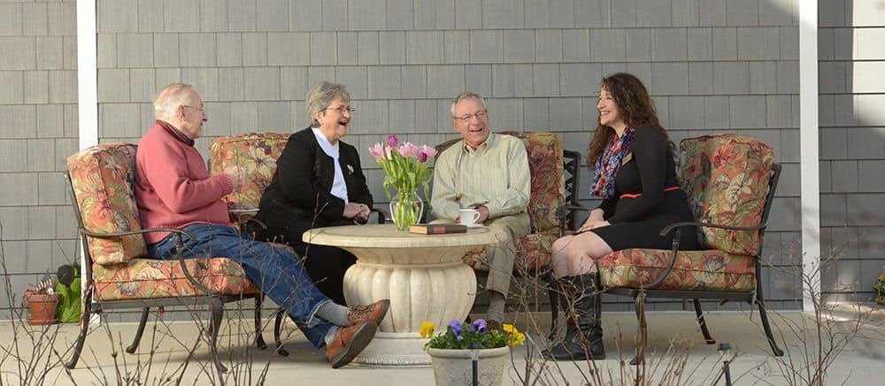 Senior friends enjoy the patio at Symphony Manor