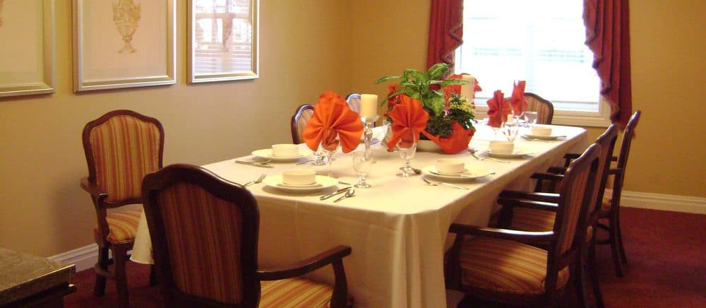 A fancy table ready for guests to have a feast at Symphony Manor