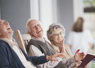 Senior living in Richmond shows residents relaxing in the sunshine