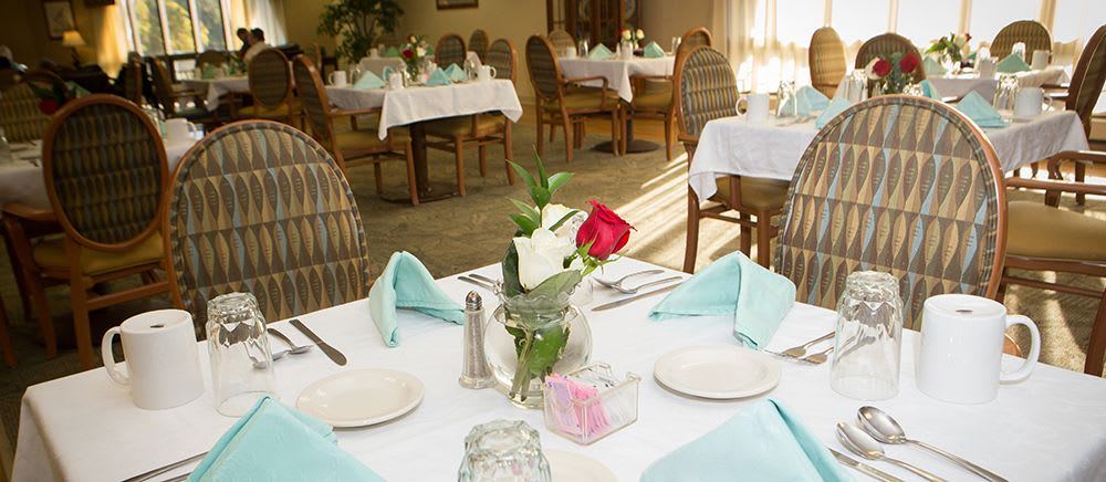 A dining table with colorful napkins at Symphony Manor of Richmond