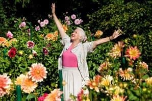 Senior dancing in a garden in Draper