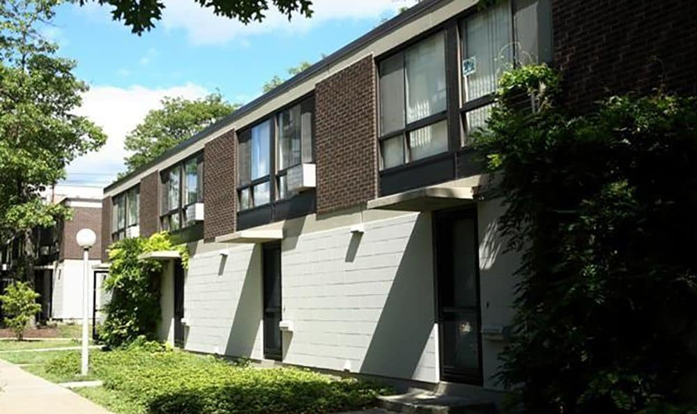 Another exterior view of Fairview Apartments in Ithaca showcasing well-kept green spaces