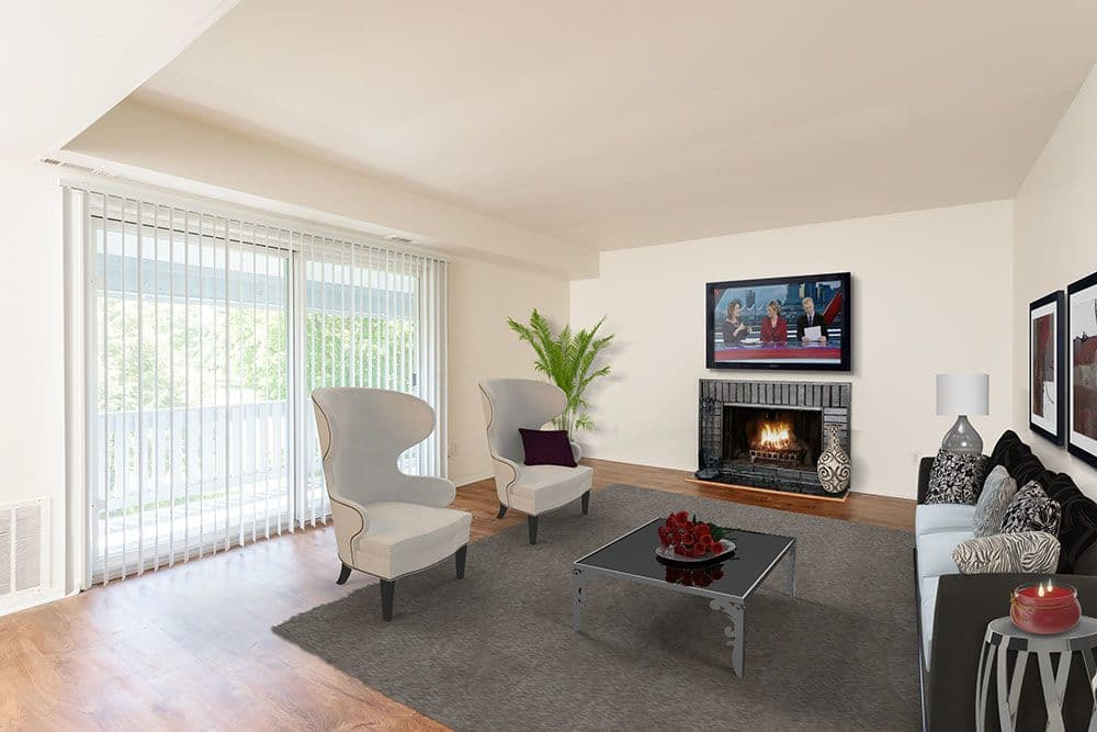 Enjoy apartments with a modern living room and fireplace at The Meadows Apartments