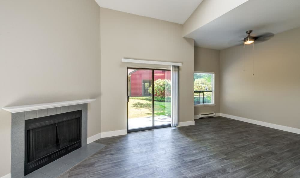 Hardwood floors and fireplace with mantel at Surprise Lake Village
