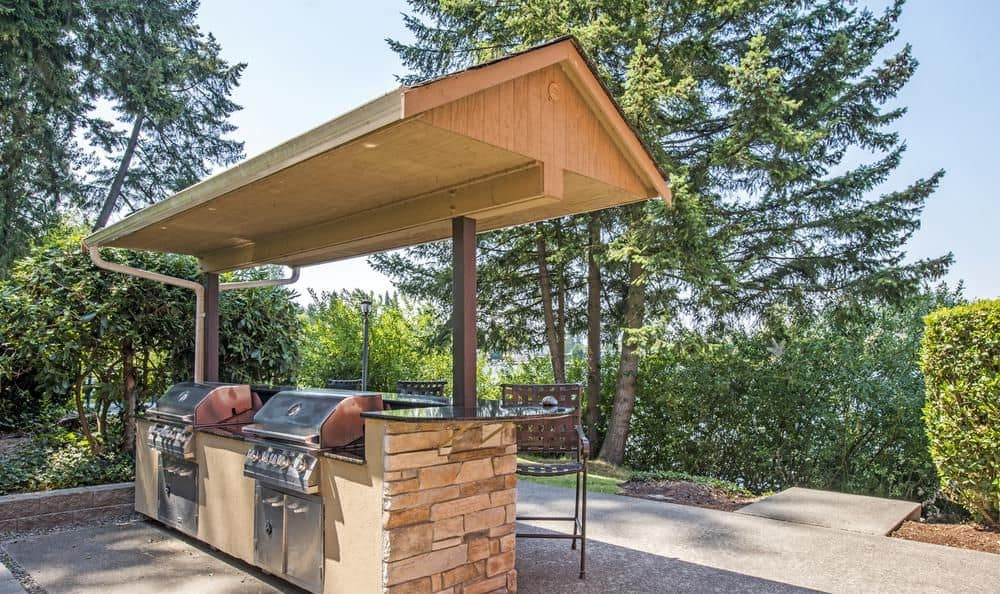 A bbq area that is great for entertaining at Surprise Lake Village in Milton, Washington