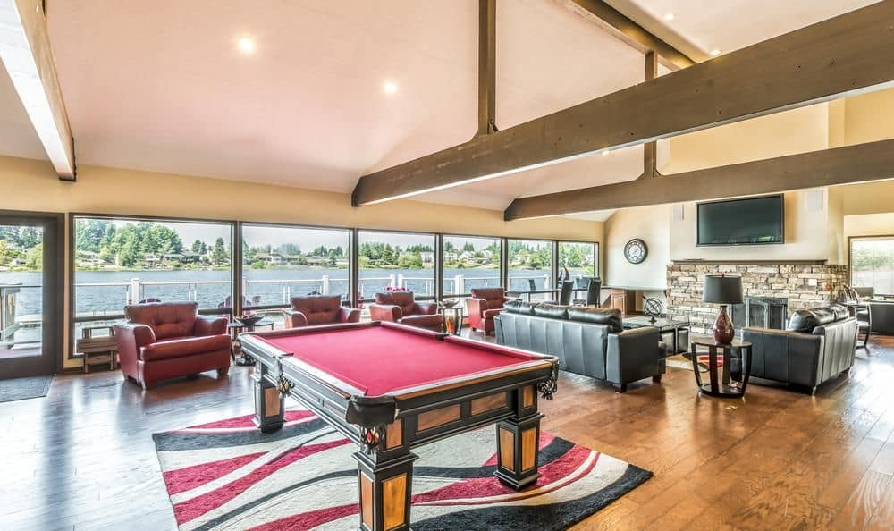 Interior clubhouse view at Surprise Lake Village showcasing the pool table and comfortable furniture