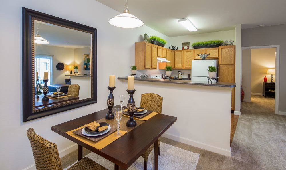 Dining room and kitchen view at Crescent at Wolfchase home in Memphis, TN