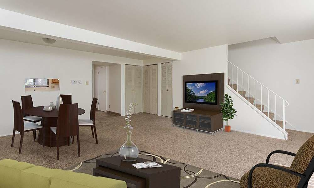 Beautifully designed living room at High Acres Apartments and Townhomes in Syracuse