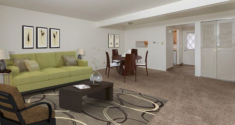 Spacious living room at High Acres Apartments and Townhomes home in Syracuse, NY