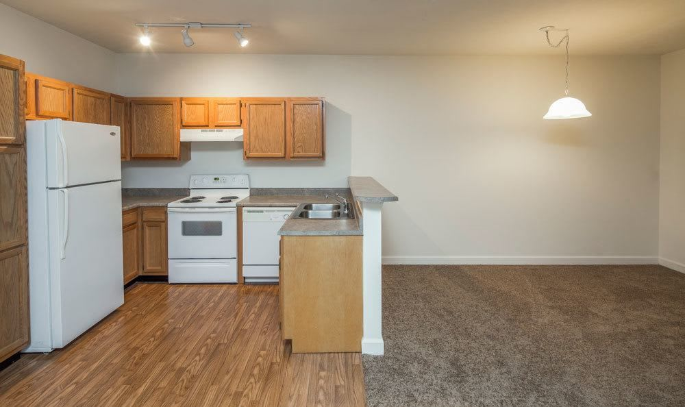 Open floor plan space and well-equipped kitchen at Main Street Apartments home in Huntsville, AL