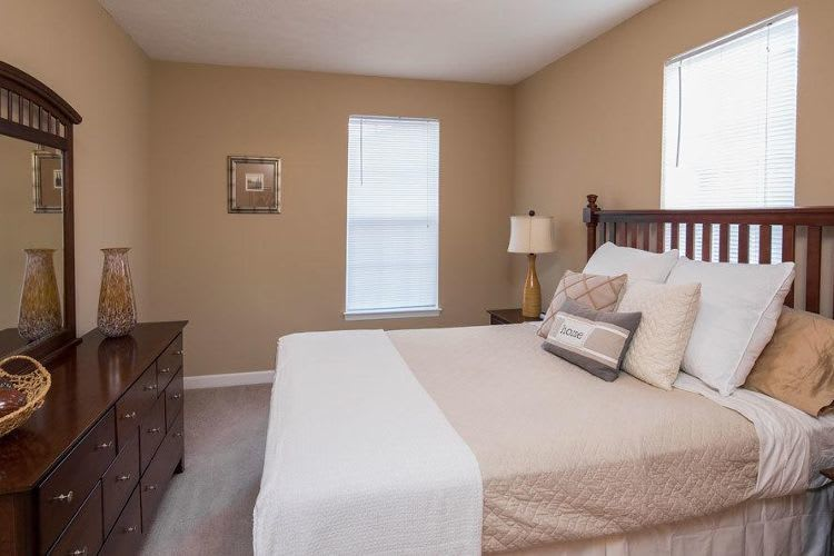 Well decorated bedroom at Main Street Apartments in Huntsville, Alabama